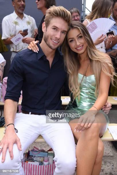 Influencer Caroline Einhoff and her boyfriend Jeff Kasser attend the Marina Hoermanseder show during the Berlin Fashion Week Spring/Summer 2019 at...