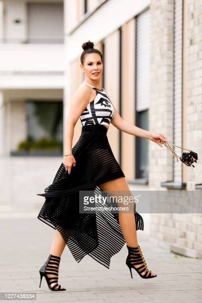 Influencer Dany Michalski wearing a blackwhite top by American Apparel a black net skirt by Plein Sud black heels by Balmain a Love bracelet by...