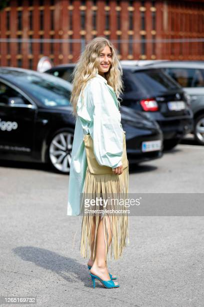 Influencer Emili Sindlev is seen wearing mint colored dress, blue mules by Bottega Veneta and a beige bag with long fringes by Bottega Veneta seen at...