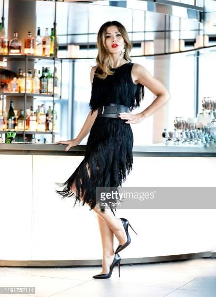 Influencer Fuesun Lindner is seen wearing a black MADELEINE fringe dress on November 20, 2019 in Baden-Baden, Germany.
