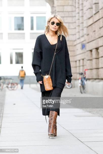 Influencer Gitta Banko is wearing an oversized black wool cardigan and a black wool skirt by Boscana x Gitta Banko, a black ribbed tanktop by Zara,...