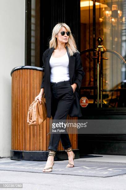 Influencer Gitta Banko is wearing an oversized black wool cardigan and a black wool skirt by Boscana x Gitta Banko a black ribbed tanktop by Zara...