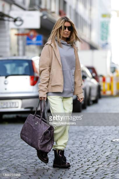 Influencer Gitta Banko wearing a apricot colored jacket by Tekin Apparel, a lavender colored hoodie by Tekin Apparel, lime green colored sweat pants...