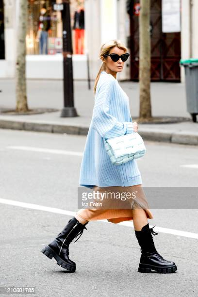 Influencer Gitta Banko wearing a apricot colored ripped knit bra a tank top and skirt by Boscana black monolith boots by Prada a oversized iceblue...