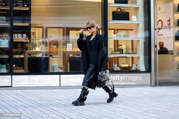 Influencer Gitta Banko wearing a black blazer by Saint Laurent a black vegan culotte by Nanushka a black tank top by Zara black chunky combat boots...