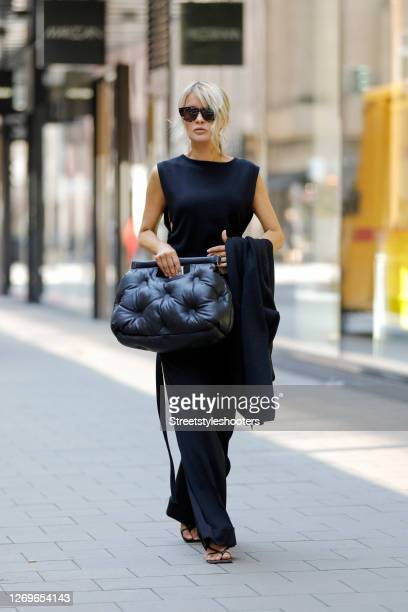 Influencer Gitta Banko wearing a black crop top by Annette Goertz, black low waist pants by Annette Goertz, black sandals by Bottega Veneta, black...
