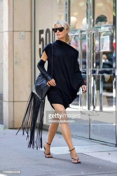 Influencer Gitta Banko wearing a black dress with asymmetrical shoulders by Annette Goertz, black sandals by Bottega Veneta, sunglasses by Bottega...