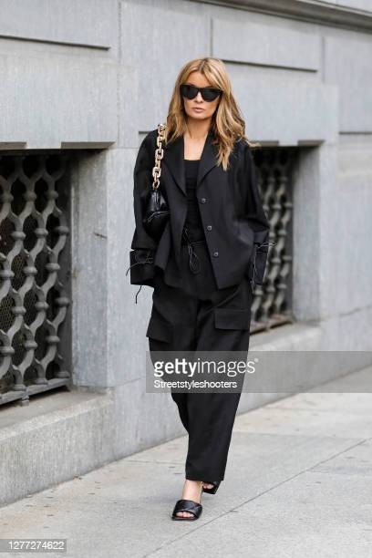 Influencer Gitta Banko, wearing a black short oversize blazer with cut out details and black pants by Annette Goertz, a black tank top by Zara, a...