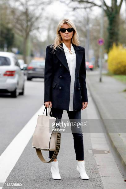 Influencer Gitta Banko wearing a black skinny Jeans by Zara a white silk blouse a black fitted blazer with shoulder pads by Jacob Lee a beige colored...