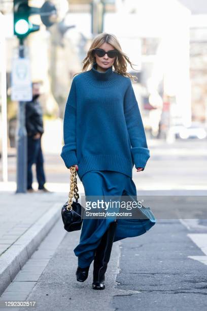 Influencer Gitta Banko wearing a blue cashmere maxi skirt with a long slit by Canessa Cashmere, a matching blue oversize cashmere turtleneck pullover...