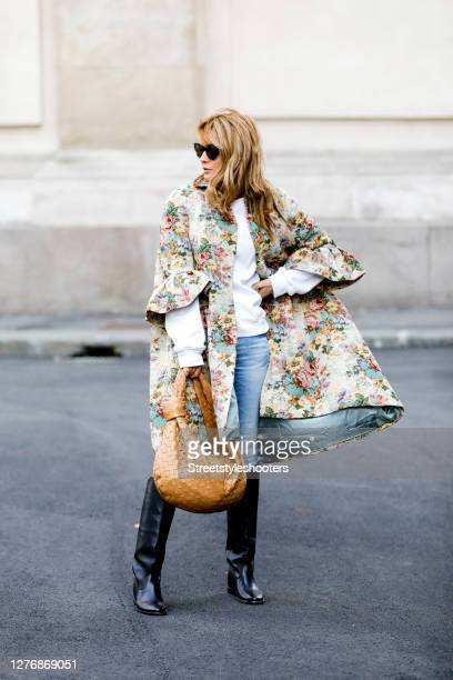 Influencer Gitta Banko, wearing a brokat coat with floral print by Celin, a Jeans by Jeans AG, black knee boots by Isabel Marant, a creme colored...