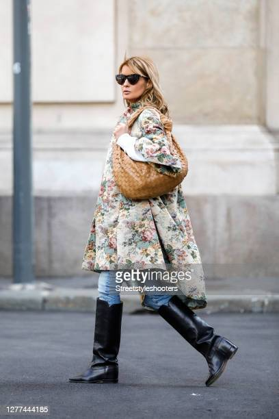 Influencer Gitta Banko, wearing a brokat coat with floral print by Celine, a light blue jeans by Jeans AG, black knee high boots by Isabel Marant, a...