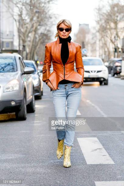 Influencer Gitta Banko, wearing a brown tailored leather jacket by Pearl and Rubies, a brown leather bag by Boscana, a black cashmere sweater by...