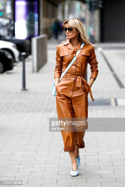 Influencer Gitta Banko, wearing a caramel colored leather jumpsuit by Pearl& Rubies, a topaz colored padded cassette bag by Bottega Veneta, crunch...