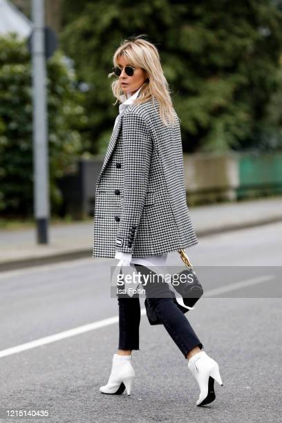 Influencer Gitta Banko, wearing a checked blazer with shoulder pads by Jacob Lee, a white tanktop by Zara, a long oversized white blouse by Balossa,...