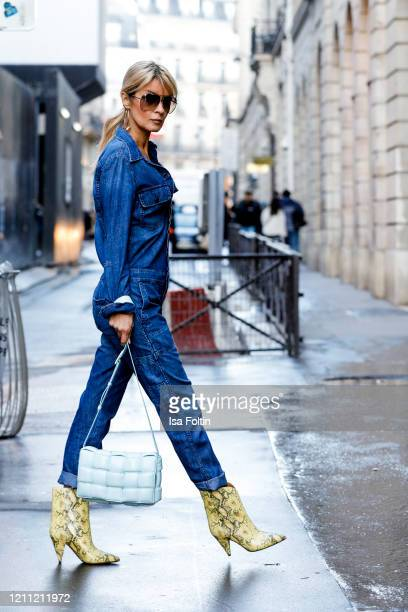 Influencer Gitta Banko, wearing a dark blue denim jumpsweat by Citizens of Humanity, yellow colored snake cowboy boots by Isabel Marant, a topas blue...