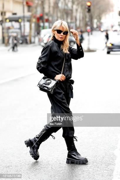 Influencer Gitta Banko, wearing a dark grey jumpsweat by Bella Dahl, a black turtleneck sweater by Boscana, monolith boots by Prada, a black Fendi...
