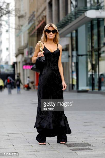 Influencer Gitta Banko, wearing a dress over pants look with black jacquard pants by zara, a black jacquard silk dress by Essentiel Antwerp, a black...