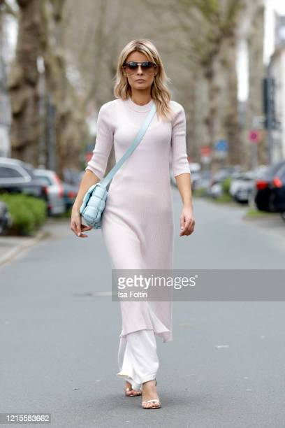 Influencer Gitta Banko, wearing a dress over pants look with white knitted pants by Nobili cashmere, a pastell rose knitted dress by t7Berlin, a...