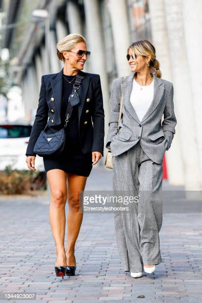 October 04: Influencer Gitta Banko, wearing a grey checked suit by Summum Amsterdam, a white top by Riani, white pumps by Balenciaga, a beige bag by...