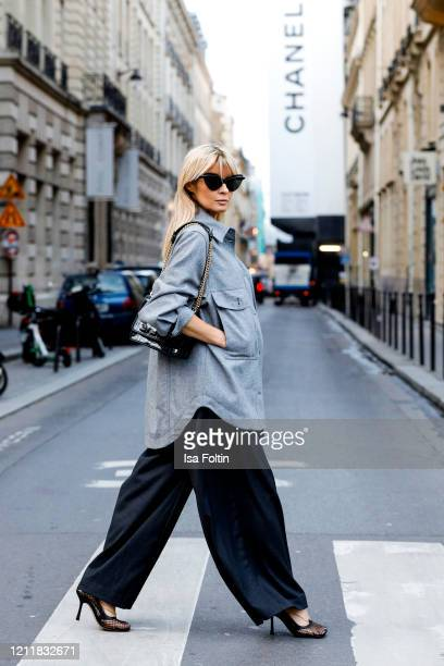 Influencer Gitta Banko, wearing a grey oversized blouse by H&M, high waist double belted stripe pants by Balossa, a shirt by Redirection, shoes by...