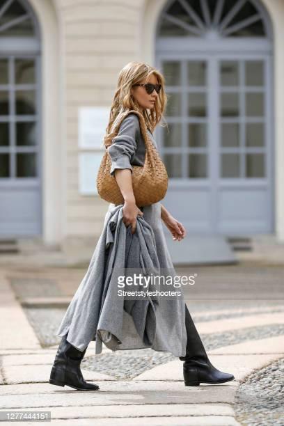 Influencer Gitta Banko, wearing a grey oversized coat by Boscana, a grey wrapper by Zara, a black tank top by Zara, a caramel colored jodie bag by...