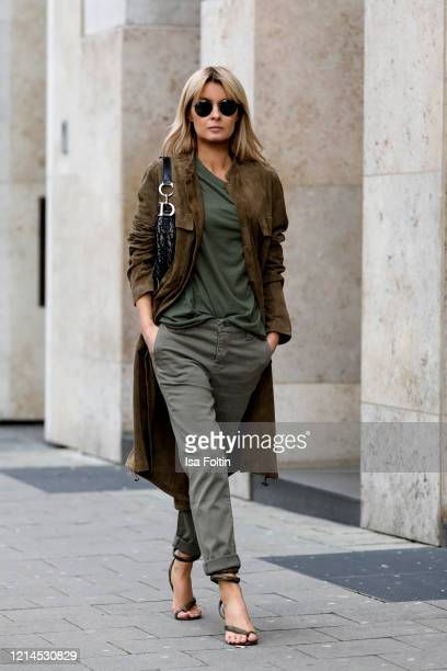 Influencer Gitta Banko wearing a khaki colored leather coat by Annette Goertz khaki pants by J Brand sandals with spiral ankle strap in pythonprinted...