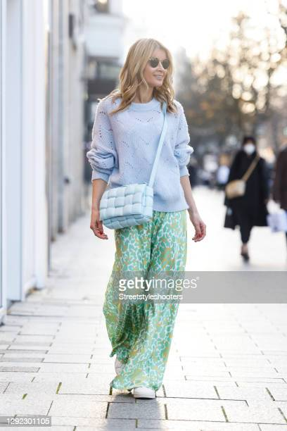 Influencer Gitta Banko wearing a lavender colored knitted pullover by Delicatelove, a light green and yellow maxi silk skirt with leopard print by...