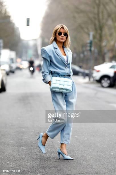 Influencer Gitta Banko, wearing a light blue jeans blazer and jeans by Magda Butrym, light blue colored crunch sharpei pumps by Bottega Veneta, a...