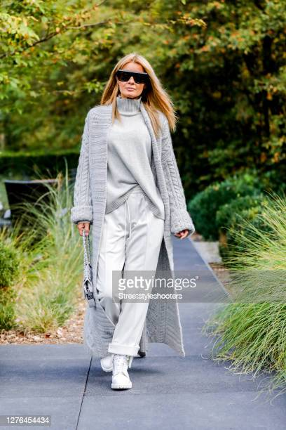 Influencer Gitta Banko, wearing a light grey floor lenght cashmere cardigan with plait pattern by The Mercer NY, a light grey cashmere turtleneck...