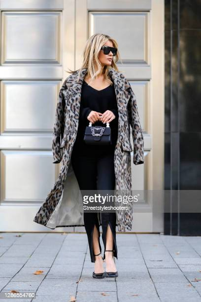 Influencer Gitta Banko wearing a long grey, black and brown coat with leopard pattern by Beatrice B, a balck cashmere v-neck pullover by Boscana,...