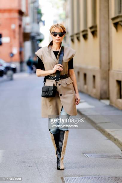 Influencer Gitta Banko, wearing a padded shoulder vest dress in tawny brown by The Frankie Shop, a Jeans by Jeans AG, two tone boots by Gestuz,...