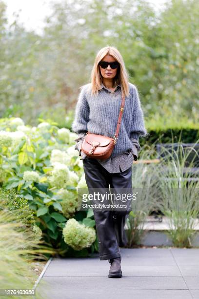 """Influencer Gitta Banko, wearing a patterned oversize blouse and a grey oversize mohair pullover with a V neckline by Boscana,""""nkhaki colored leather..."""