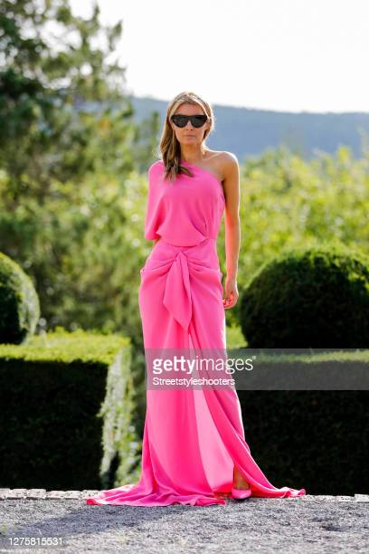 Influencer Gitta Banko wearing a pink evening dress by Rhea Costa and pink colored pumps by Balenciaga during a street style shooting at Manoir de...