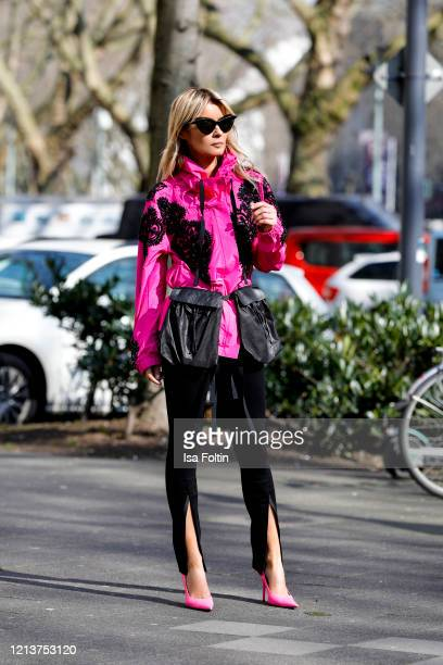 Influencer Gitta Banko, wearing a pink jacket with black embroideries and black crystals by Dries Van Noten, black front slit pants by Waredrobe.NYC,...