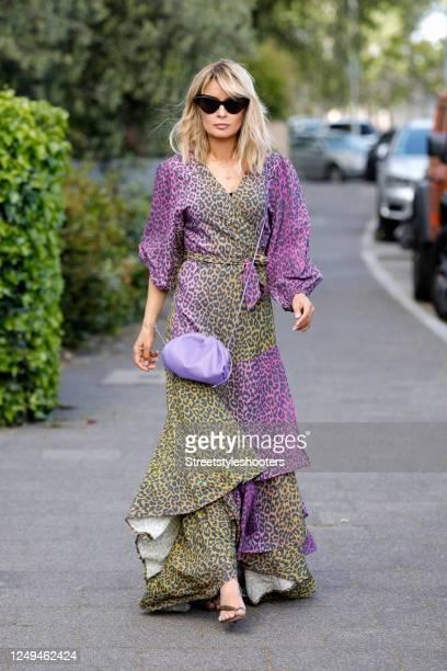 Influencer Gitta Banko, wearing a purple and light green long wrap dress by Delicatelove, a purple mini pouch bag by Bottega Veneta, sandals by...