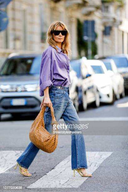 Influencer Gitta Banko, wearing a purple colored oversize blouse by Gitta Banko,a pearl necklace by Hermina Athens, a golden necklace by Bottega...