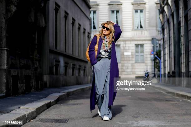 Influencer Gitta Banko, wearing a purple oversize knitted coat by The Mercer NY, a multicolored blousee by Etro, grey pants ba Zara, a camel colored...