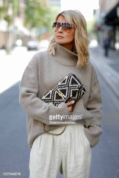 Influencer Gitta Banko wearing a sand colored knitted turtle neck pullover by Zoe Ona cream colored corduroy pants by Isabel Marant a blue and white...
