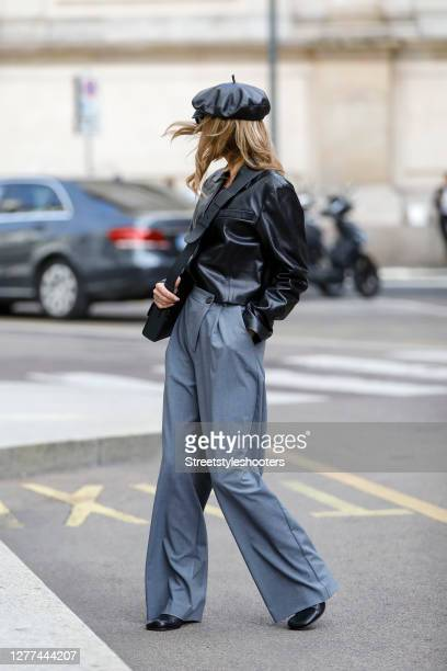 Influencer Gitta Banko, wearing a short leather blazer and grey pants with an asymetric zipper by Zara, a black 30 montaigne box bag by Dior, a black...
