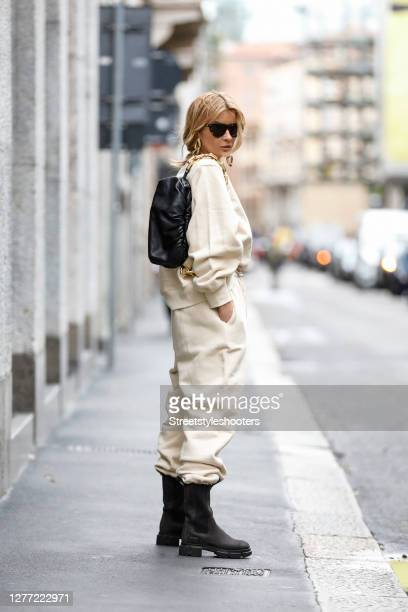 Influencer Gitta Banko, wearing a vanilla colored oversize sweater with shoulder pads and matching vanilla colored balloon sweatpants by the Frankie...