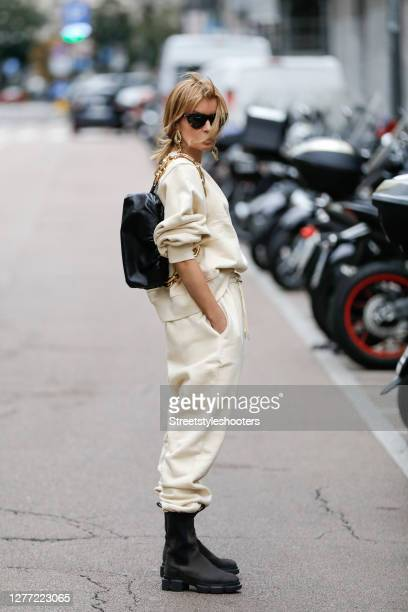 Influencer Gitta Banko wearing a vanilla colored oversize sweater with shoulder pads and matching vanilla colored balloon sweatpants by the Frankie...