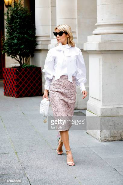 Influencer Gitta Banko, wearing a white loop blouse and a leather pencil skirt by Boscana, a belt bag by Chanel, sandals by Sophia Webster and...