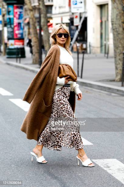 Influencer Gitta Banko, wearing a white mohair sweater by Boscana, a brown long cardigan by Essentiel Antwerp, a leo printed silk skirt by Delicate...