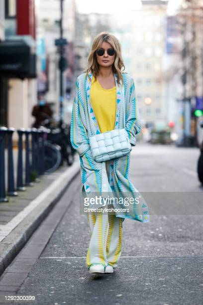 Influencer Gitta Banko wearing a yellow t-shirt by American Vintage, yellow and turquoise knitted pants and a matching long cardigan by Delicatelove,...