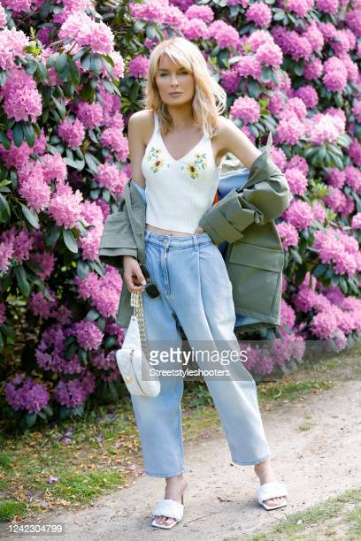Influencer Gitta Banko, wearing an olive green parker by G-Lab, a knitted white shirt with flower embroidery by H&M, light blue denim jeans by Magda...
