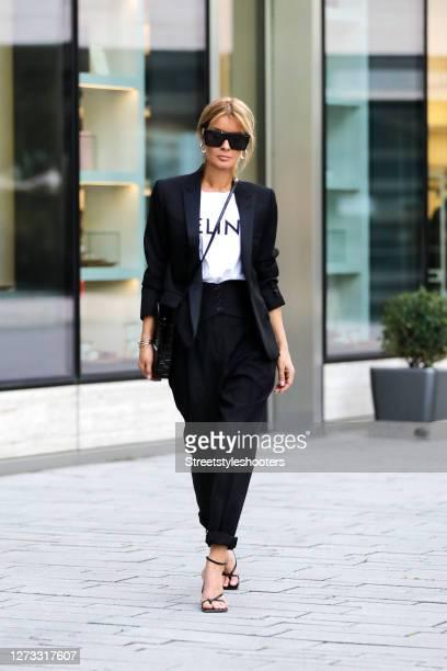 Influencer Gitta Banko wearing black high waist pants by Saint Laurent a black blazer by Saint Laurent a white tshirt with black logo print by Celine...