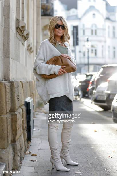 Influencer Gitta Banko wearing cream colored over knee boots by Proenza Schouler, a grey pencil skirt by Gianfranco Ferre, a khaki colored...