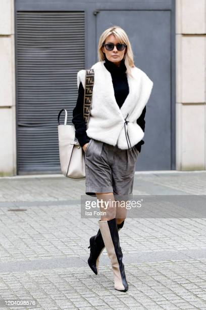 Influencer Gitta Banko, wearing leather shorts and a black turtleneck sweater by Boscana, a white fake fur vest by Liviana Conti, two toned boots by...