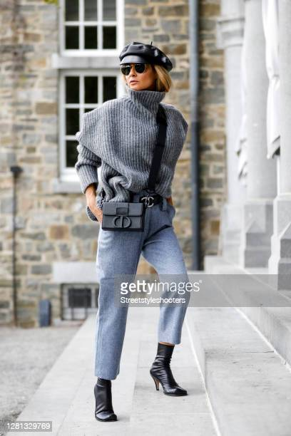 Influencer Gitta Banko, wearing light blue wool pants and a light grey pullover by Boscana, a black 30 Montaigne bag by Dior, a black beret by Dior,...